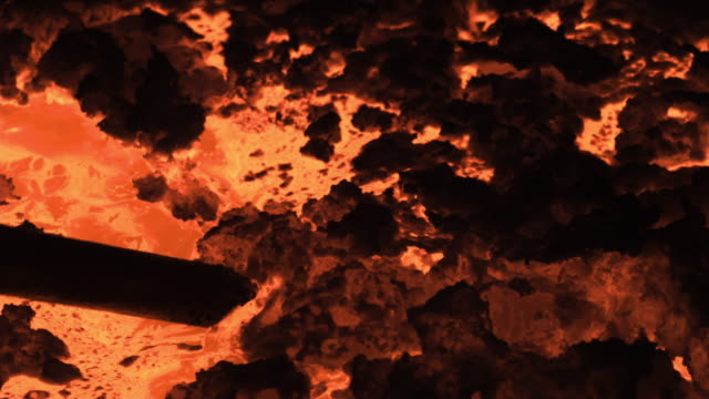 slow motion close shot on a vat of molten iron. - molten stock videos and b-roll footage