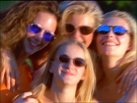 slow motion close up 4 blonde women wearing sunglasses posing for camera outdoors - endast tonårsflickor bildbanksvideor och videomaterial från bakom kulisserna