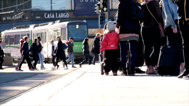 slow motion close up at foot : routine life of european people running into tram cable car at bus stop. - helsinki video stock e b–roll