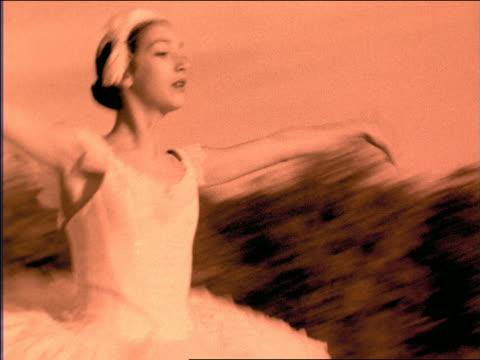 vídeos y material grabado en eventos de stock de b/w orange slow motion close up pan ballerina leaping past camera outdoors - imagen virada
