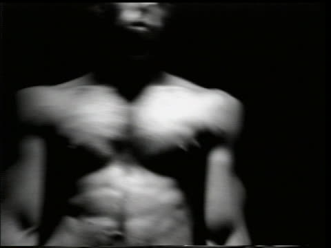 b/w slow motion close up bare-chested man dancing in tormented fashion - 胴体点の映像素材/bロール
