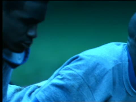 blue slow motion close up pan black + caucasian men doing pushups - bodyweight training stock videos & royalty-free footage