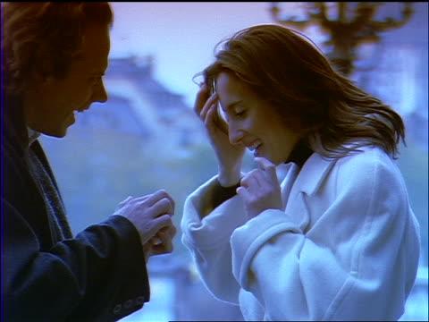 vídeos de stock, filmes e b-roll de slow motion close up blue man surprising woman with engagement ring / they hug / paris - noivado