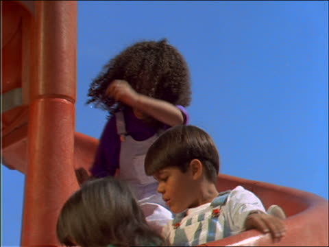 slow motion close up children sliding down spiral slide - 2001 stock videos and b-roll footage