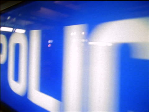 slow motion close up dolly shot blue police sign - beliebiger ort stock-videos und b-roll-filmmaterial