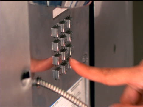 slow motion close up finger of woman dialing on payphone / hangs up telephone receiver - 1998 stock-videos und b-roll-filmmaterial