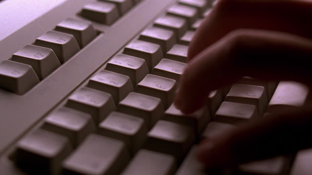 slow motion close up fingers typing on computer keyboard - computer keyboard stock videos & royalty-free footage