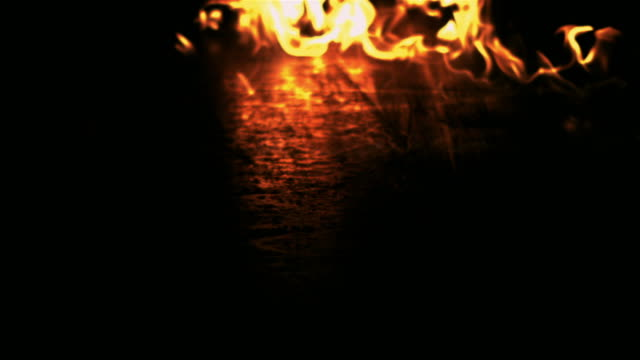 slow motion close up flames creeping along surface - arson stock videos & royalty-free footage