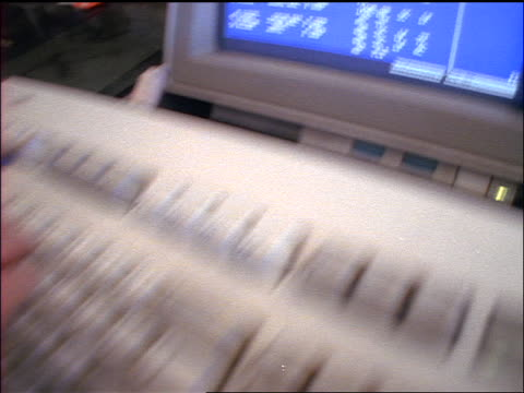 slow motion close up pan hands typing on airline terminal keyboard / computer monitor displays data / o' hare - 1998 stock-videos und b-roll-filmmaterial