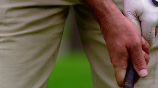 selective focus slow motion close up man's hands wearing golf glove gripping golf club - golf glove stock videos and b-roll footage