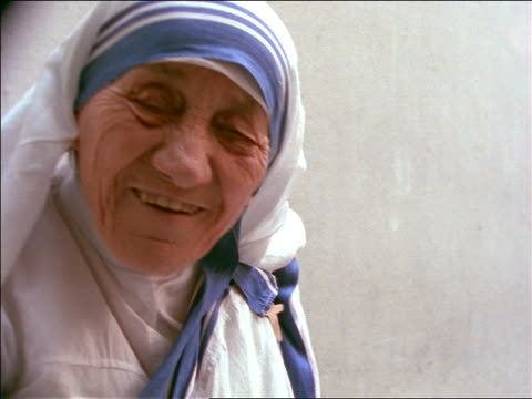 slow motion close up mother teresa talking nodding head / india - human age stock videos & royalty-free footage