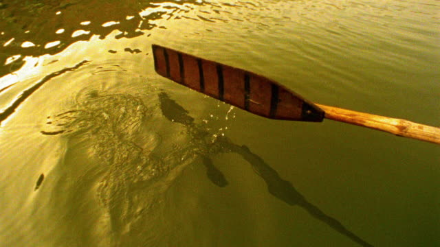 slow motion close up oar of rowboat moving through water of ganges river / varanasi, india - oar stock videos & royalty-free footage