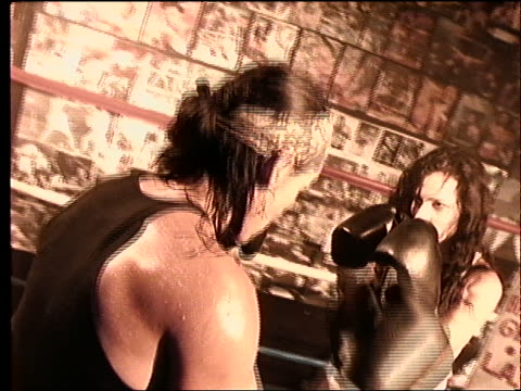 slow motion close up of 2 women boxing - boxing women's stock videos & royalty-free footage