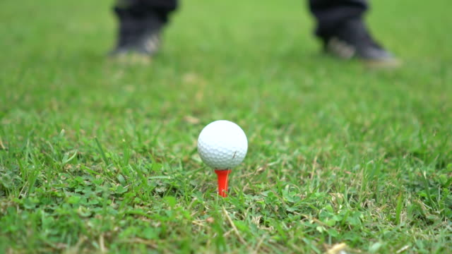 slow motion: close up of a tee shot - drive ball sports stock videos and b-roll footage