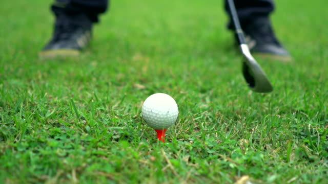 slow motion: close up of a tee shot - golf ball stock videos & royalty-free footage