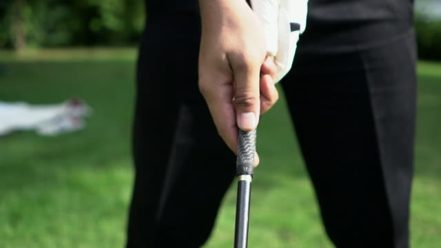 slow motion: close up of a tee shot - golf club stock videos & royalty-free footage