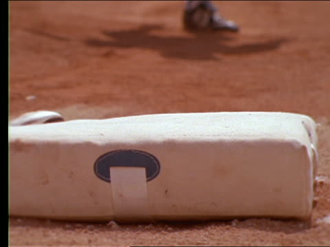 slow motion close up of baseball player sliding into base - sliding stock videos & royalty-free footage