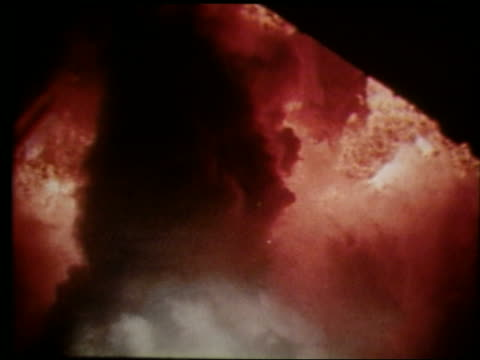 slow motion close up of flames and smoke from rocket blastoff - rakete stock-videos und b-roll-filmmaterial