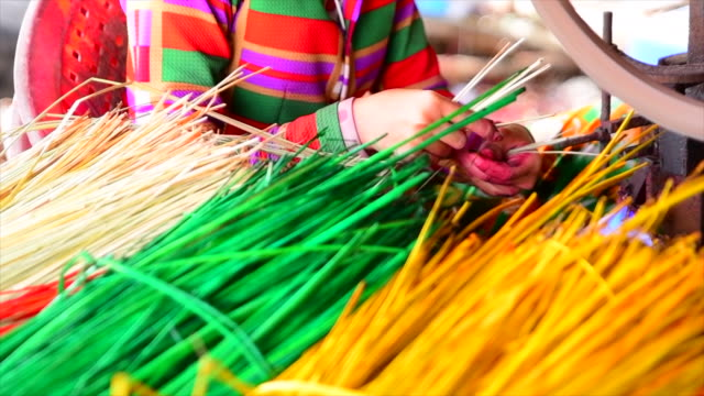 4k slow motion close up of hand weaving mat with machine - mekong delta stock videos & royalty-free footage