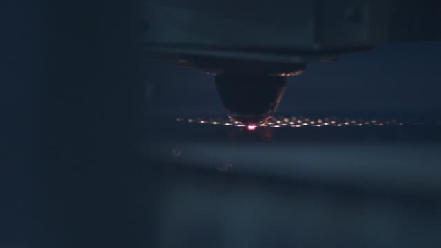 vídeos de stock, filmes e b-roll de slow motion close up of laser cutter as it punches holes in a sheet of metal. - pushing