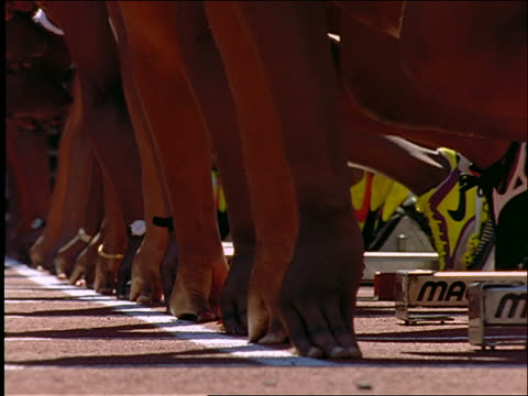 slow motion close up of runners' hands + feet at starting line / they take off - 1997 stock videos & royalty-free footage