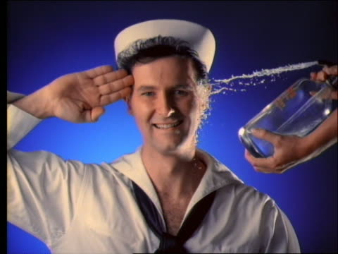 slow motion close up of seltzer water being sprayed in sailor's face - saluting stock videos & royalty-free footage