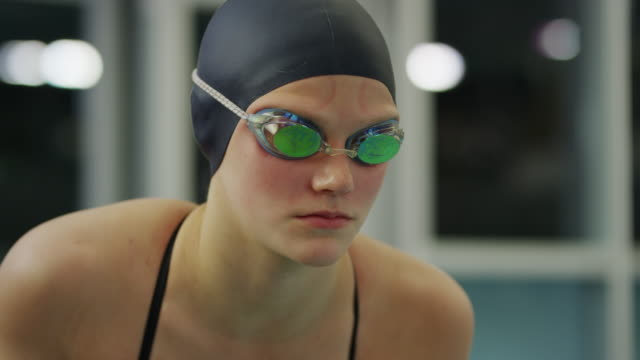 slow motion close up of serious girl before swimming / provo, utah, united states - provo stock videos & royalty-free footage