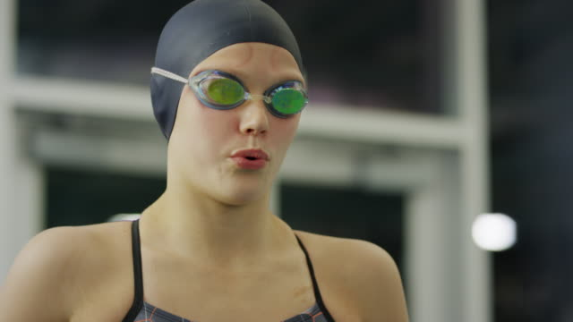 slow motion close up of serious girl warming up before swimming / provo, utah, united states - provo stock videos & royalty-free footage