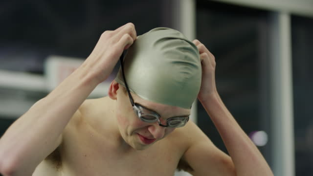 slow motion close up of smiling boy adjusting goggles before swimming / provo, utah, united states - provo stock videos and b-roll footage