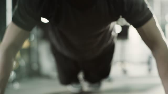 slow motion close up of sweating man doing push-ups / american fork, utah, united states - push ups stock videos & royalty-free footage