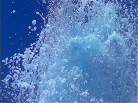 slow motion close up of water shooting into air - wet stock videos & royalty-free footage