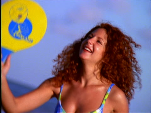 slow motion close up of woman in bikini playing paddle ball on beach - one piece swimsuit stock videos & royalty-free footage