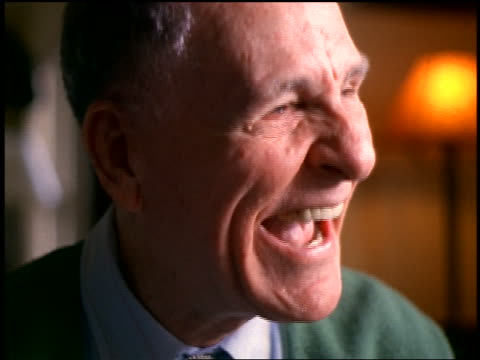 slow motion close up portrait senior man laughing uncontrollably indoors - senior men stock videos & royalty-free footage