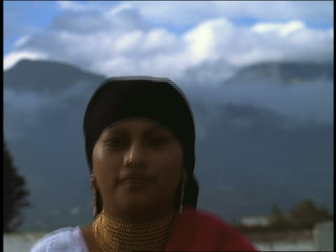 slow motion close up portrait young woman in native dress standing up + smiling / otavalo, ecuador - ecuadorian ethnicity stock videos & royalty-free footage