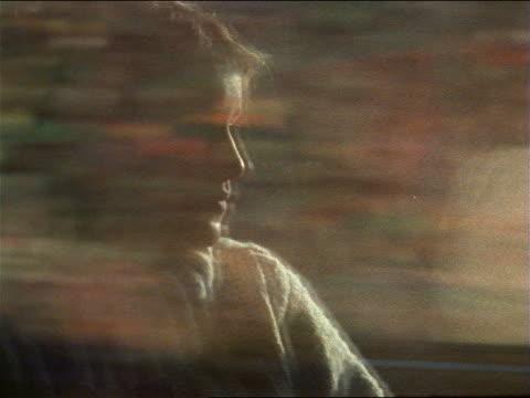 vídeos y material grabado en eventos de stock de slow motion close up profile pensive teen girl by window with reflections of passing scenery on moving train - sólo chicas adolescentes