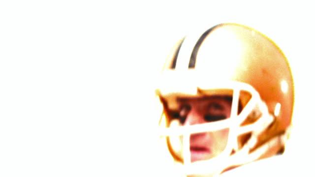 overexposed slow motion close up quarterback throwing football + pointing - クオーターバック点の映像素材/bロール