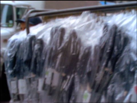 slow motion close up racks of clothing on street in chinatown / new york city - medium group of objects stock videos & royalty-free footage