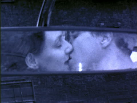 b/w blue slow motion close up reflection of gen x couple kissing in rear view mirror of taxi - kissing stock videos & royalty-free footage