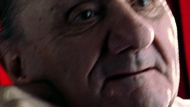 slow motion close up PAN senior man looking somber
