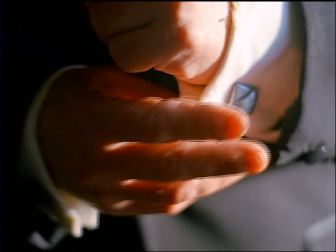stockvideo's en b-roll-footage met slow motion close up senior man wearing tuxedo raising arm + adjusting cuff link with fingers - elite