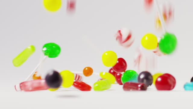 Slow motion close up shot of abundant candy falling and bouncing / Cedar Hills, Utah, United States