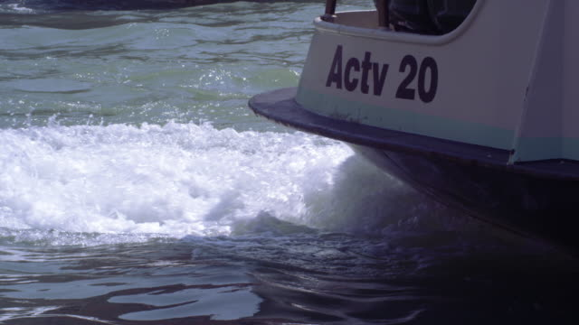 slow motion, close up shot of the turbulent water created by the ferry's propellers - propeller stock videos & royalty-free footage