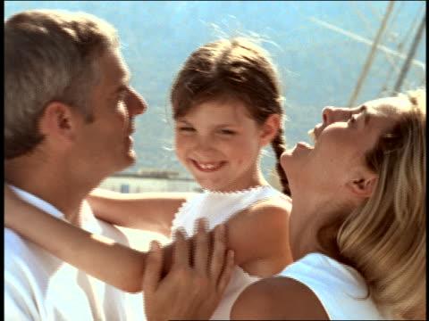vídeos de stock e filmes b-roll de slow motion close up small girl + couple cuddling + kissing outdoors / corsica - 1990