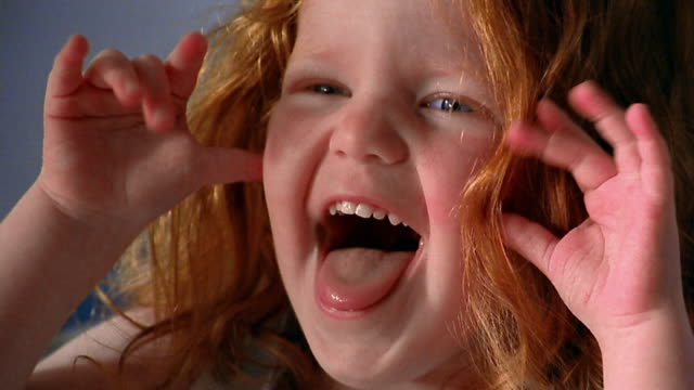slow motion close up small redhead girl making faces - ohövlighet bildbanksvideor och videomaterial från bakom kulisserna