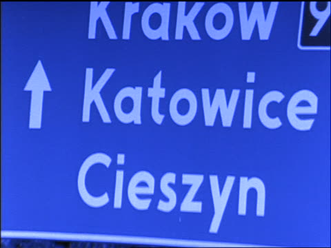 "blue slow motion close up tilt up road sign for 'krakow"" and 'katowice"" / poland - poland stock videos & royalty-free footage"