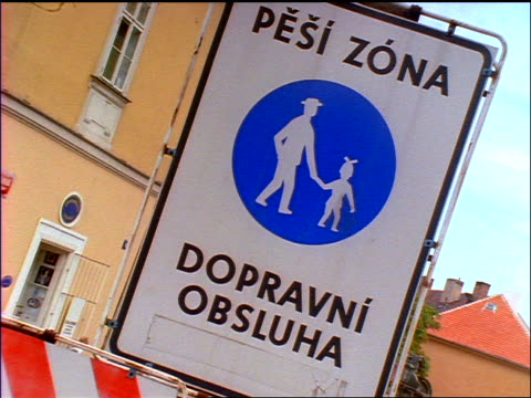 "slow motion close up PAN to ""Pedestrian Zone / Service Vehicles Only"" sign / Prague, Czech Republic"