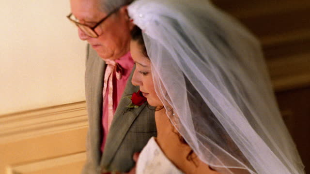 slow motion close up tracking shot hispanic bride and father walking - father of the bride stock videos and b-roll footage
