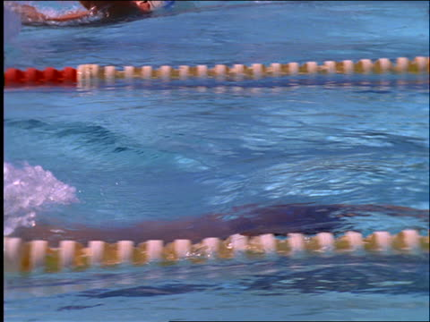 stockvideo's en b-roll-footage met slow motion close up tracking shot of man swimming breast stroke in race - buitenbad