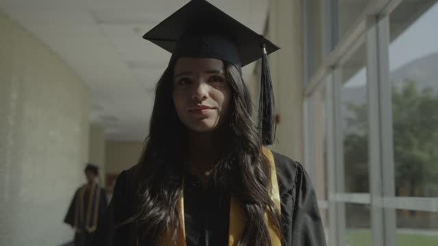 slow motion close up tracking shot of teenage girl graduating from high school / springville, utah, united states - springville utah stock videos & royalty-free footage