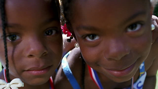 slow motion close up twin small black girls posing - twin stock videos & royalty-free footage